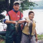 Boat captain Al Gagliarducci of Agawam, MA and Alex Neves of Danbury, CT.  Alex placed 2nd in Level I-A in the Big Fish category with a 2.79 pound bass. - Friday, August 18, 2000
