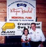 Ray Kerchal presenting a 2nd place trophy to Maria Contreras of Danbury, CT.  Maria caught 24 fish in Level I-B - Friday, August 18, 2000