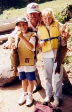 Boat captain Rick Wertheim from Bellingham, MA with Jonathan Contreras and Tanya Carlson of Danbury, CT.  Tanya caught the big fish of the week, a 4 pound - 9 ounce smallmouth bass. - Wednesday, August 16, 2000
